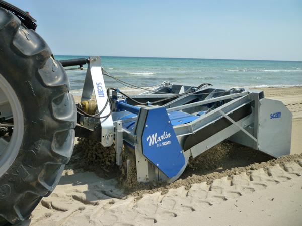 Pulizia spiaggia trainata