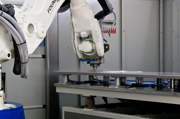 Impianto produzione piani cucina t d robotics for Piani di produzione