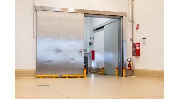 Shockproof protections for industrial doors