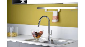 Tall one-hole sink mixer with pull-out hand shower and swiveling spout