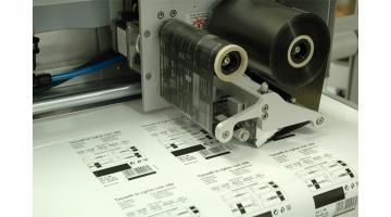 Stampante totale per confezionatrici