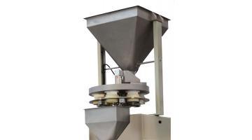 Dosatore a tazze per confezionatrice verticale