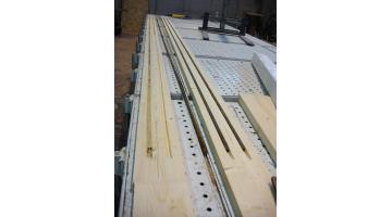 Legno lamellare rinforzato con barre in acciaio