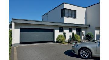 Portone garage sezionale energeticamente efficiente