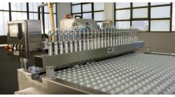 Macchina automatica per riempimento e dosaggio di cere depilatorie